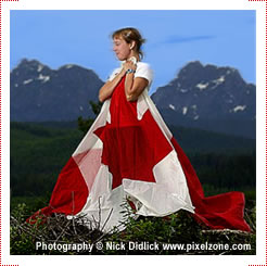 Dana Asher stands with the Canadian flag